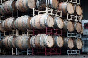 Stacks of empty wine barrels outside of Laurel Ridge Winery